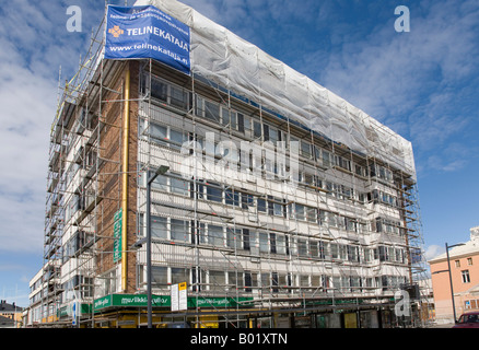 Scaffolding and block of flats under renovation Oulu , Finland - Stock Photo