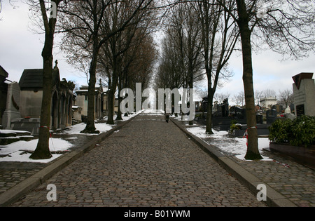 Making a visit to a gravesite in Pere Lachaise cemetery in Paris France - Stock Photo
