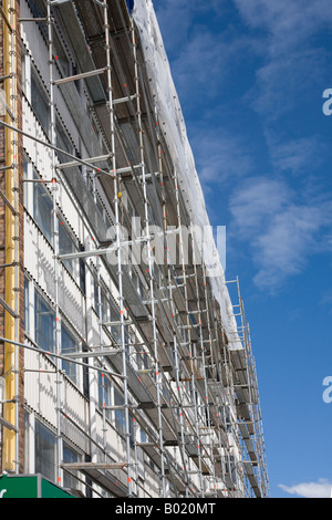 Metal scaffolds and block of flats under renovation Oulu , Finland - Stock Photo