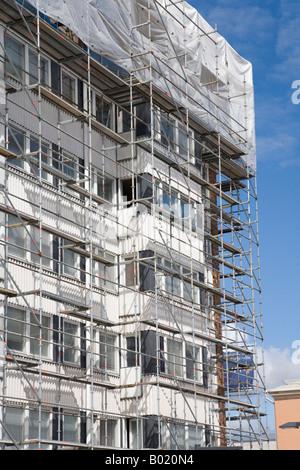 Metal scaffolds around block of flats under renovation Oulu , Finland - Stock Photo