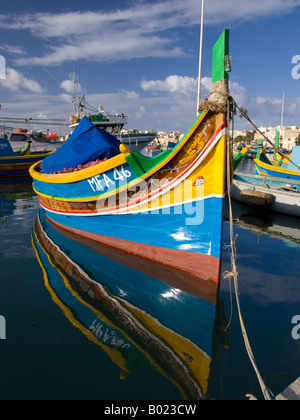 A luzzu, a colourful traditional Maltese fishing vessel in Marsaxlokk Harbour, Marsaxlokk, Malta. - Stock Photo