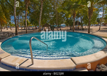 La romana dominican republic dominicus tourists on the beach club stock photo 48054752 alamy - Palm beach swimming pool ...
