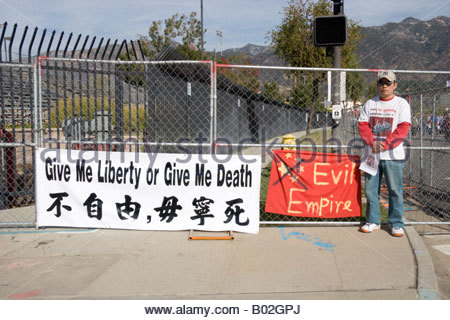Chinese Democracy Freedom Protester at the 2008 Tournament of Roses Parade Rose Float Viewing Pasadena California - Stock Photo