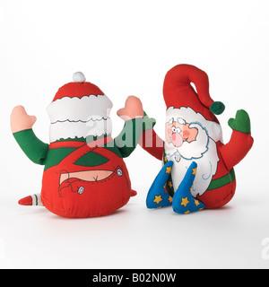 Santa Claus Christmas elf toys on white background - Stock Photo