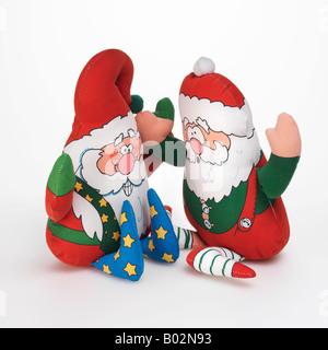Santa Claus Christmas elves toys on white background - Stock Photo