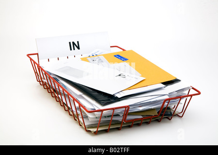 full red wire mesh office post in tray for incoming mail letters bills junk mail flyers leaflets and invoices - Stock Photo