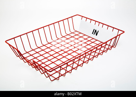 empty red wire mesh office post in tray for incoming mail - Stock Photo