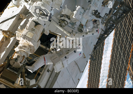 Astronaut participating in extravehicular activity. - Stock Photo