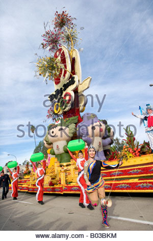 Chinese Dancers and Rose Float Representing the Beijing China Olympics at the 2008 Tournament of Roses Parade Pasadena - Stock Photo