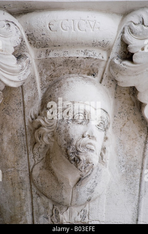Venice, Veneto, Italy. Detail from the top of a pillar from the arches of the portico showing Head of Egyptian - Stock Photo