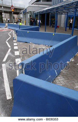 Concrete barriers outside City Airport London The barrieirs were put in place to prevent car bombs being driven - Stock Photo