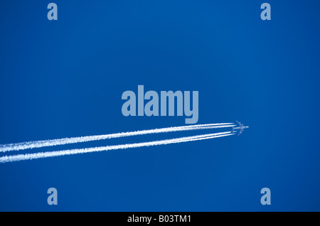 Plane in a blue sky. - Stock Photo