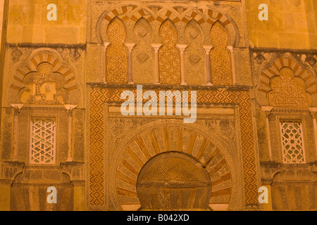 Highly decorated doorway on the west wall of the Mezquita (Cathedral-Mosque) at night in the City of Cordoba - Stock Photo
