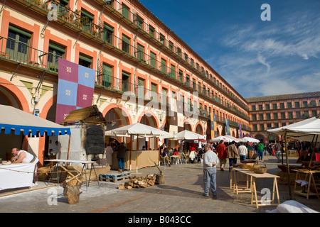 Plaza de la Corredera and market stalls during a medieval festival in the old City of Cordoba, UNESCO World Heritage - Stock Photo