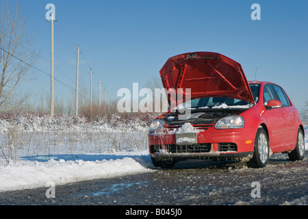 Car with Hood Up in Winter on Country Road - Stock Photo