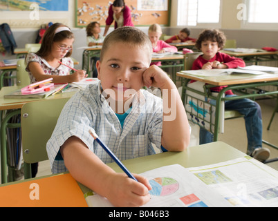 Portrait of a boy in class - Stock Photo