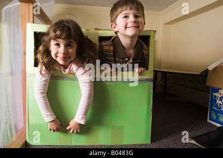 Children playing in a box - Stock Photo