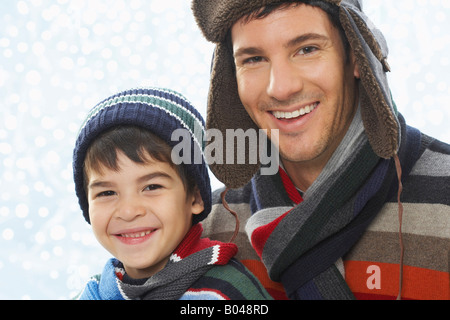 Portrait of Father and Son Wearing Winter Clothing - Stock Photo