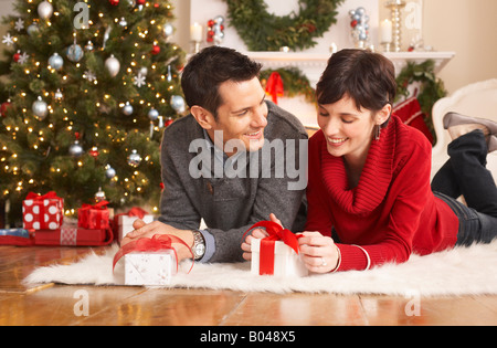 Couple Opening Christmas Presents - Stock Photo