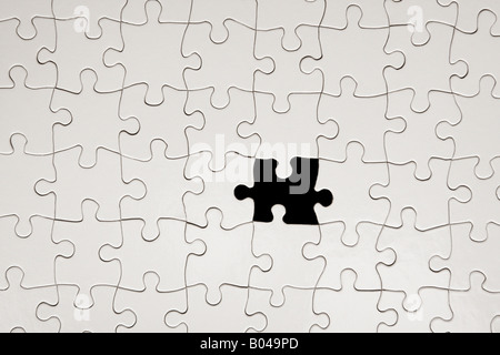 Jigsaw puzzle with missing piece - Stock Photo