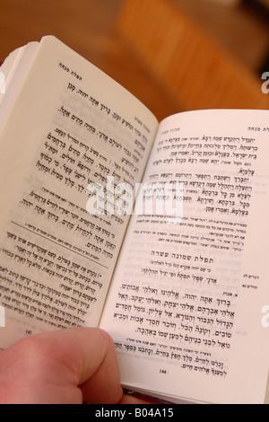 Jewish religion book of prayer with Hebrew language text - Stock Photo