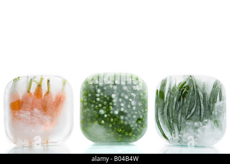 Frozen carrots peas and green beans - Stock Photo