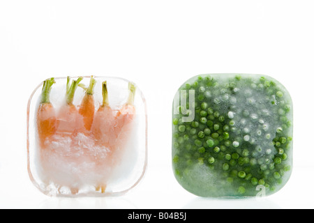 Frozen carrots and peas - Stock Photo