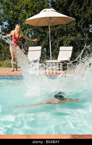 A couple having fun in a swimming pool - Stock Photo