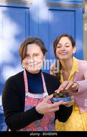 Italian mother and daughter with olives - Stock Photo