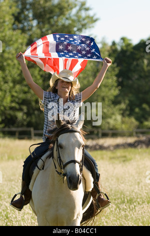 A girl holding the american flag - Stock Photo