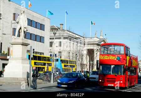 Dublin City Centre O Connell Street Statue of Sir John Gray and a tour bus with a backdrop of the historic GPO building - Stock Photo