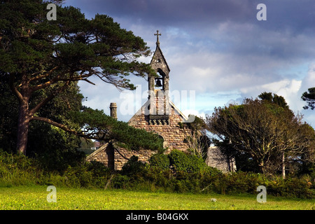 This is Nicholaston church on South Gower, in South Wales. It it was restored by Miss Olive Talbot and remains a - Stock Photo