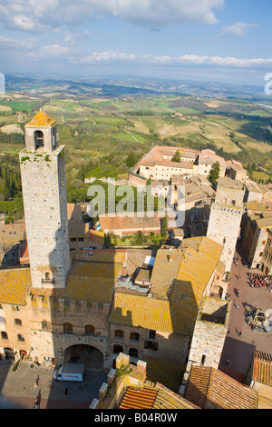 Palazzo Vecchio del Podesta in Piazza del Duomo and rooftops seen from Torre Grossa in the historic old town centre - Stock Photo