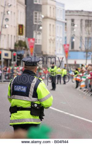 Garda man (Irish Policeman) at Saint Patrick's day Parade, Cork, Ireland - Stock Photo