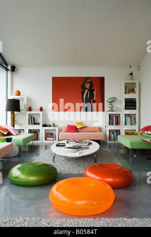 Brightly coloured zanotta pouffes in contemporary London apartment - Stock Photo