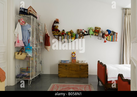 Child's bedroom in converted 1950s factory - Stock Photo
