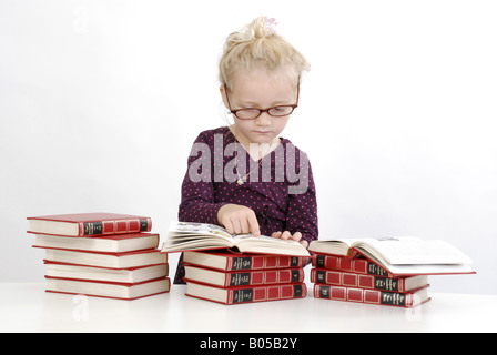 little girl reading in lexicon - Stock Photo