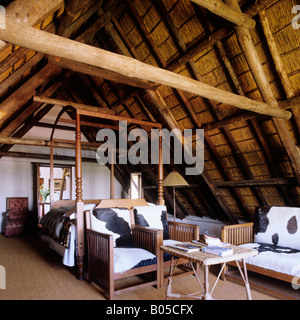 bedroom under the rafters in South African Cape Dutch homestead - Stock Photo