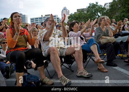 Audience clapping at the 2007 Montreal International Jazz Festival. - Stock Photo