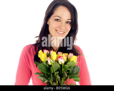 Happy Pleased Young Woman Holding A Beautiful Bunch Or Bouquet Of Colourful Mixed Flowers Isolated Against A White - Stock Photo