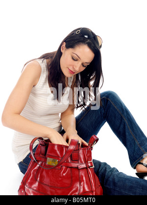 Young Woman Looking Through Bag Model Released - Stock Photo