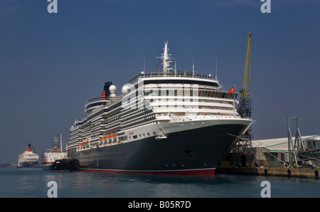 Cunard Queen Victoria and Queen Elizabeth 2 in the background, Southampton Water, Hampshire, England. - Stock Photo