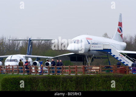 British Airways Concorde G-BOAC and Avro RJ100 on Static Display at Manchester Ringway Airport England United Kingdom - Stock Photo