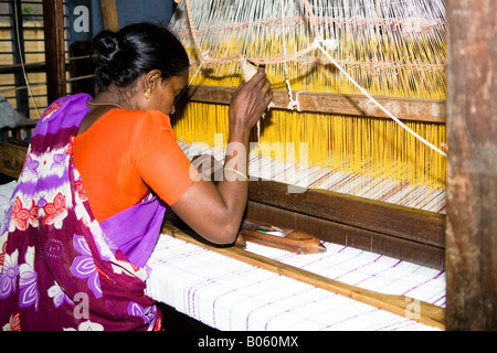 Woman working at a loom in a weaving factory, Madurai, Tamil Nadu, India