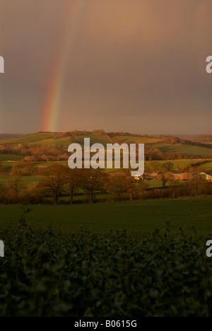 A rainbow over farmland near Brailes in Warwickshire, England, UK - Stock Photo