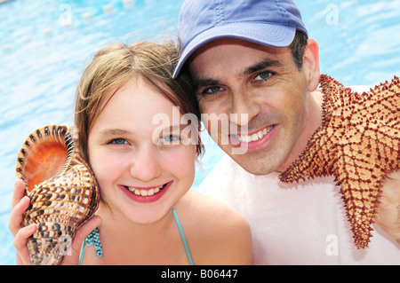 Portrait of a family enjoying tropical vacation - Stock Photo