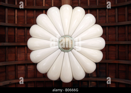 A lamp in the shape of a chrysanthemum symbol of the Japanese imperial family - Stock Photo