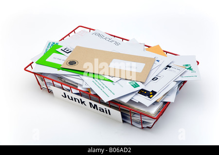 red wire mesh office post tray full of junk mail - Stock Photo