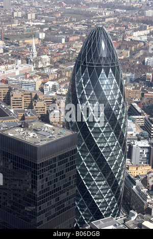 Aerial view north east of 30 St Mary Axe The Gherkin urban houses offices city of London EC2 EC3 England UK High - Stock Photo