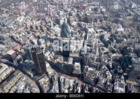 Aerial view east of 30 St Mary Axe The Gherkin National Westminster Tower 99 Bishopsgate Lloyds building urban offices - Stock Photo